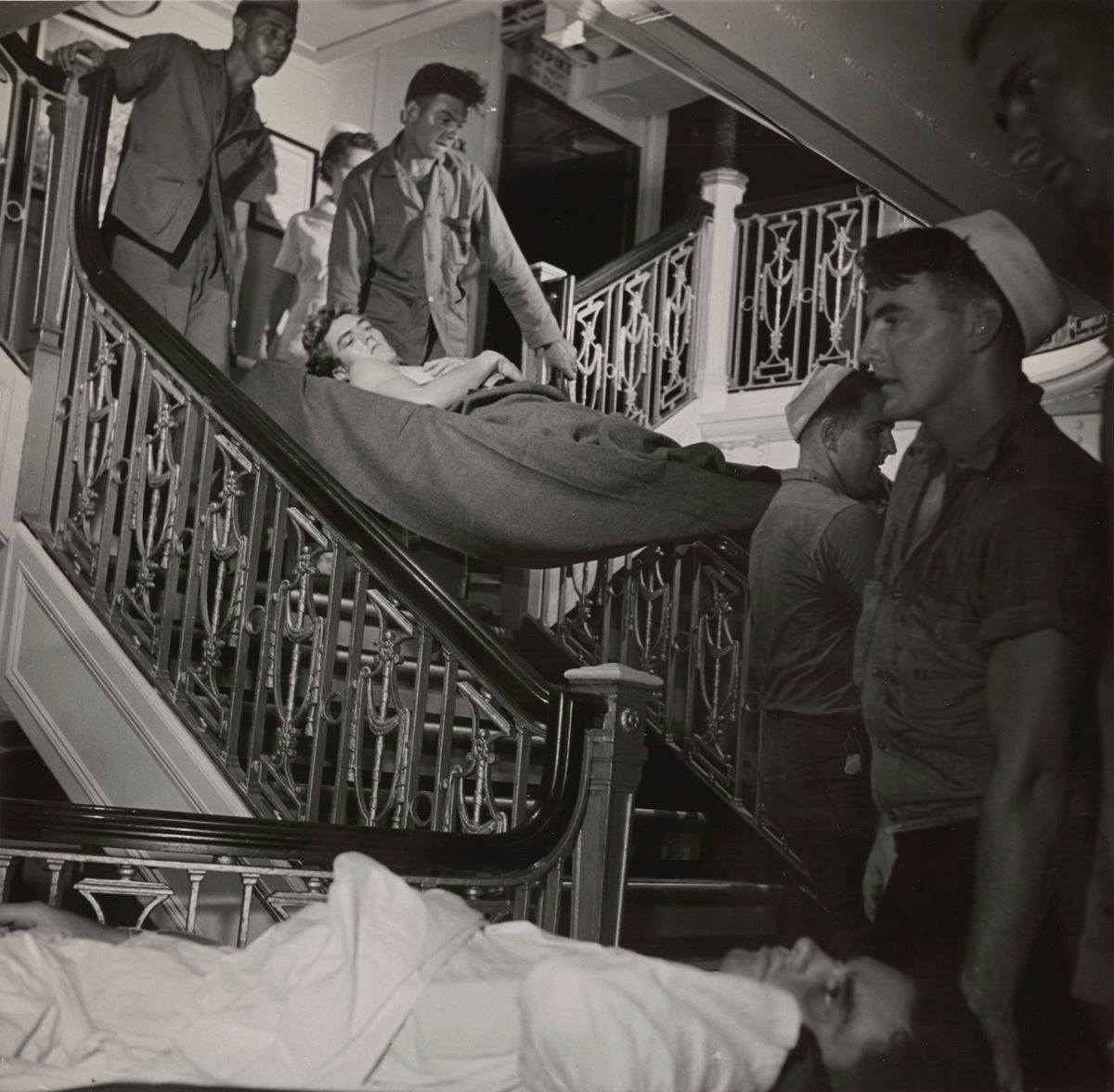 Black-and-white photos depicting quiet scenes of daily life on a hospital ship with sailors cared for by doctors, nurses, and corpsmen.