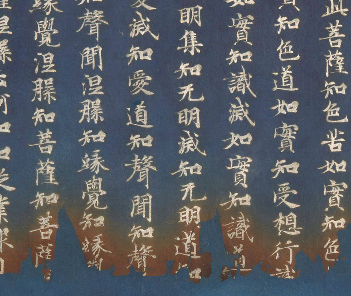 Further detail of the indigo portion of the scrolls showing 7 rows of silver calligraphy characters focusing on the rusty, burnt portion.