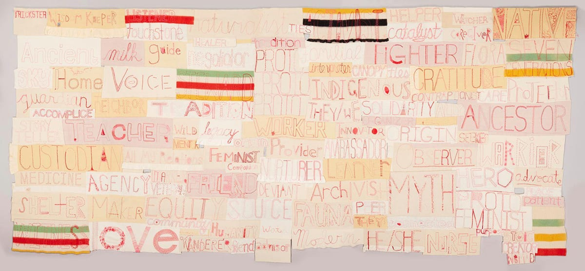 A long rectangular work composed of numerous other horizontally oriented rectangles. Each rectangle contains a word embroidered in red thread on various shades of cream to pale tan cloth in assorted stitches and styles. Some of the largest words are Ancestor, Myth, Love, Voice, Fighter, Custodian, Gratitude. Smaller words include Seeker, Care, Watcher, Legacy, Healer, Advocate, Interpreter, Wild, and Catalyst. Interspersed among the words are rectangles made of striped blankets in red, green, yellow, and black.
