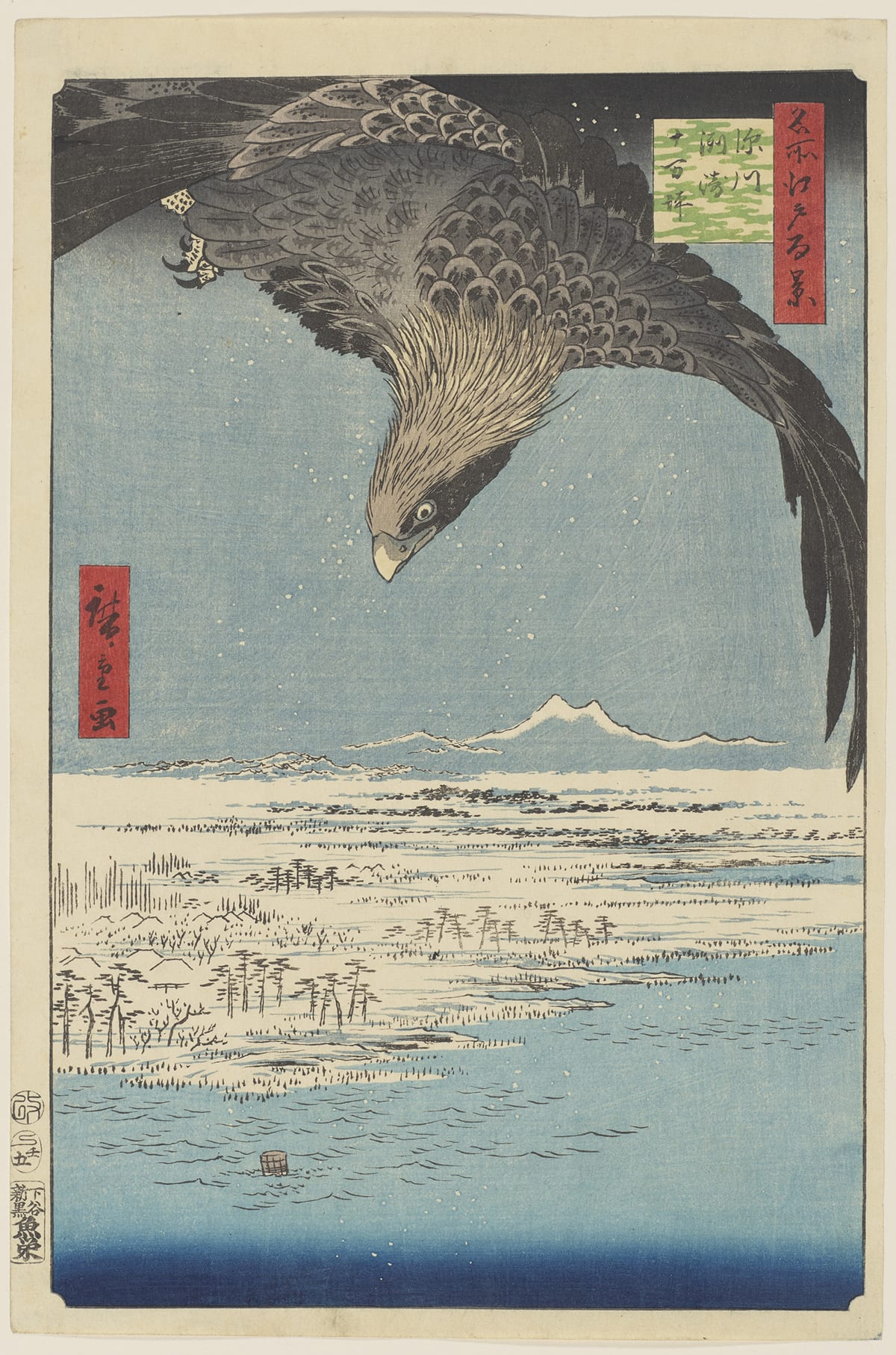 "Fukagawa Susaki and Jūmantsubo, No. 107 from the series One Hundred Famous Views of Edo, Utagawa Hiroshige, 13 3/16 in x 8 3/4 inches, color woodblock print on paper. A vertical, rectangular print showing a large bird of prey in flight with its head down and wings spread wide as flies over the land below. The bird fills the upper third of the print and is rendered in black and gray feathers with long plumage on the head. The wing on the right dips down to the lower part of the print and its talons can be seen at upper left under the bird. Below are a mountain range with two peaks and a forested landscape that meets a calm blue sea. Simple tree shapes and small hills are depicted in black on creamy, white ground with pale blue used for shading. The sea is also pale blue that gradually deepens at the bottom of the print. Simple black lines show shallow waves. ""Fukagawa Susaki and one hundred thousand tsubo"" in Japanese is printed in black ink in a green square cartouche with cloud-pattern ground at upper right. One hundred thousand tsubos is about 33 hectares. To the right of this is a red rectangular cartouche that reads ""one hundred views of famous places of Edo"" in Japanese and is printed in black ink. The artist's signature appears at far left center in a red rectangular cartouche and reads ""picture (by) Hiroshige."