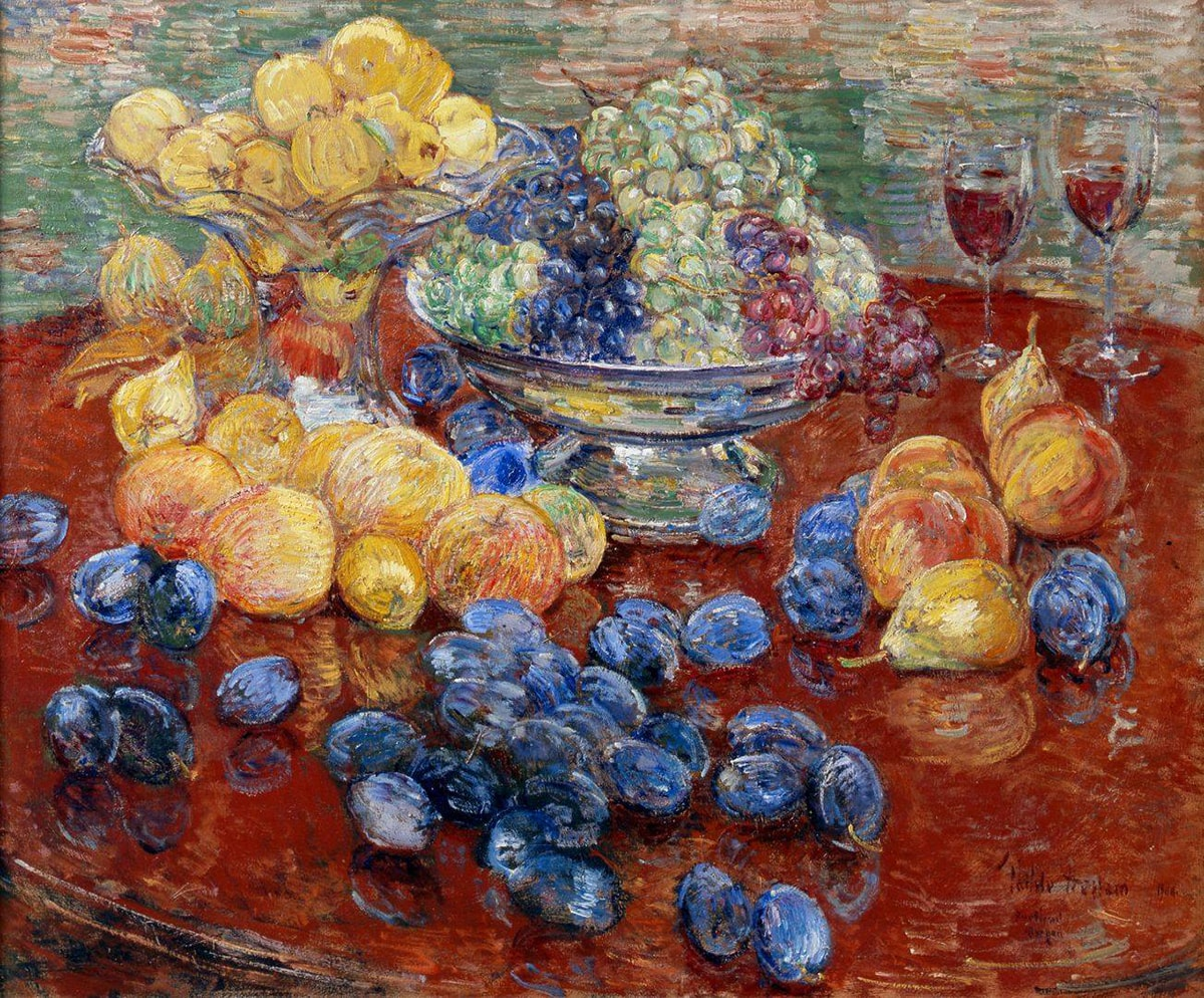 Childe Hassam. Oregon Still Life, 25 x 30 ¼ inches, oil on canvas. A painting of an assortment of fruit laid out on a round, dark brown table, the edges of which are mostly out of frame. At top, at 11 and 12 o'clock, are a glass bowl with a tall stand brimming with yellow apples that sits beside a squat, silver bowl holding green, purple, and red grapes. Just below the glass bowl are more yellow apples, some with a hint of pink. Further down the painting and scattered over the table are deep blueish-purple plums. At three o'clock are a grouping of half dozen peaches and pears set near two half-filled glasses that suggest wine. The painting technique is bold and uses dry brush strokes. Paint is heavily layered, revealing the colors underneath in areas. The table and fruit are set against a background heavily painting with horizontal strokes in muted greens, terra cotta, whites with deep yellow. Image description 2: An overhead view of a silver, wide lipped pan containing a golden cake brimming with plums.