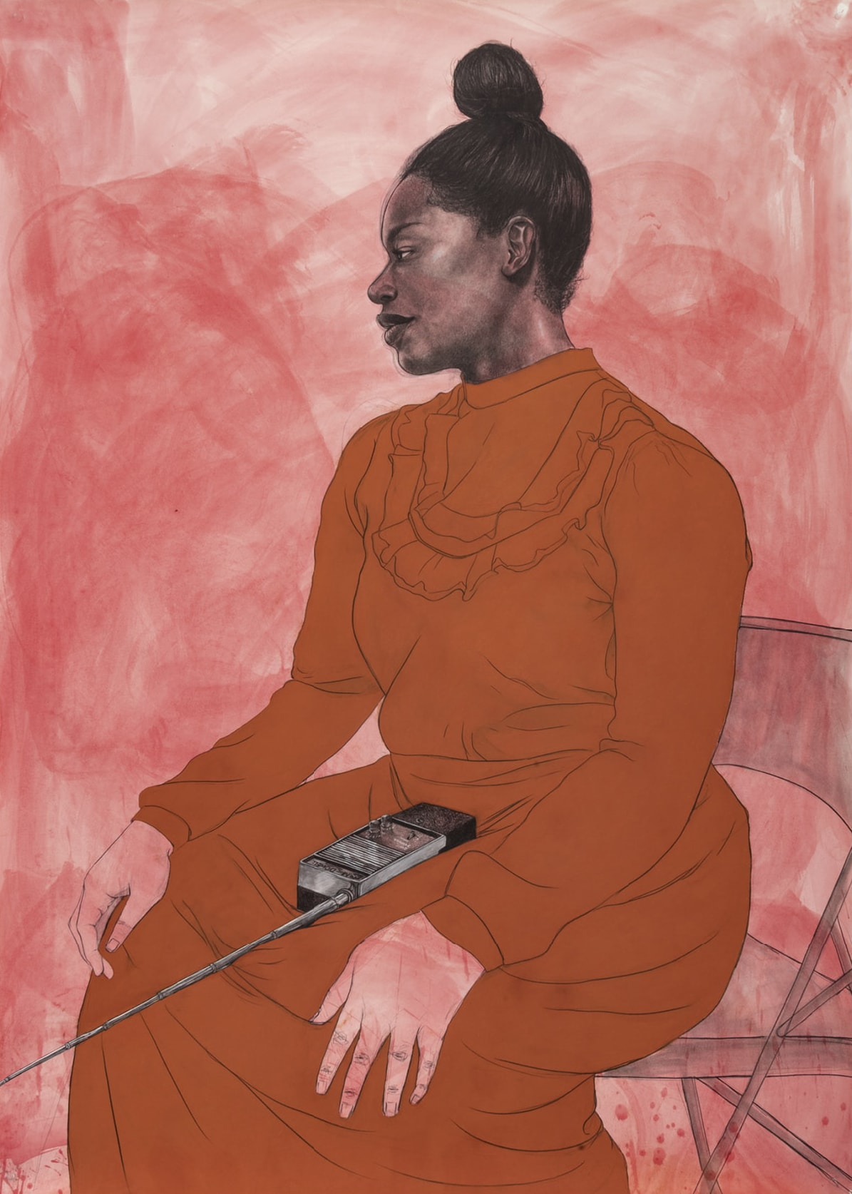 Meteorite, Robert Pruitt, conte and charcoal on dyed paper, rendered walkie-talkie with audio component. A vertical, rectangular portrait of a seated Black woman in profile wearing a long, burnt orange colored dress with a walkie-talkie in her lap, against a reddish background. The woman sits on the edge of a folding chair and is turned slightly to the left with her hands resting on her knees. Her head is turned to the left and her hair is swept up into a bun on top. Her expression is neutral. Her face and hair are rendered in careful detail in tones of gray and black with the reddish background showing through in areas. Soft white highlights touch her cheekbone, temple and lips. She wears a long sleeve, high necked dress with a U-shaped ruffle on the upper bodice. The dress is characterized by simple lines with less detail than the head of the woman. Her hands reflect the wash of reddish pigment that also unevenly fills the background of the portrait. In her lap sits a walkie-talkie, a black and silver rectangular device with a long antenna that extends out from the woman's lap beyond the edge of the work. The folding chair seen partially right is sheer gray with the reddish background again showing through.