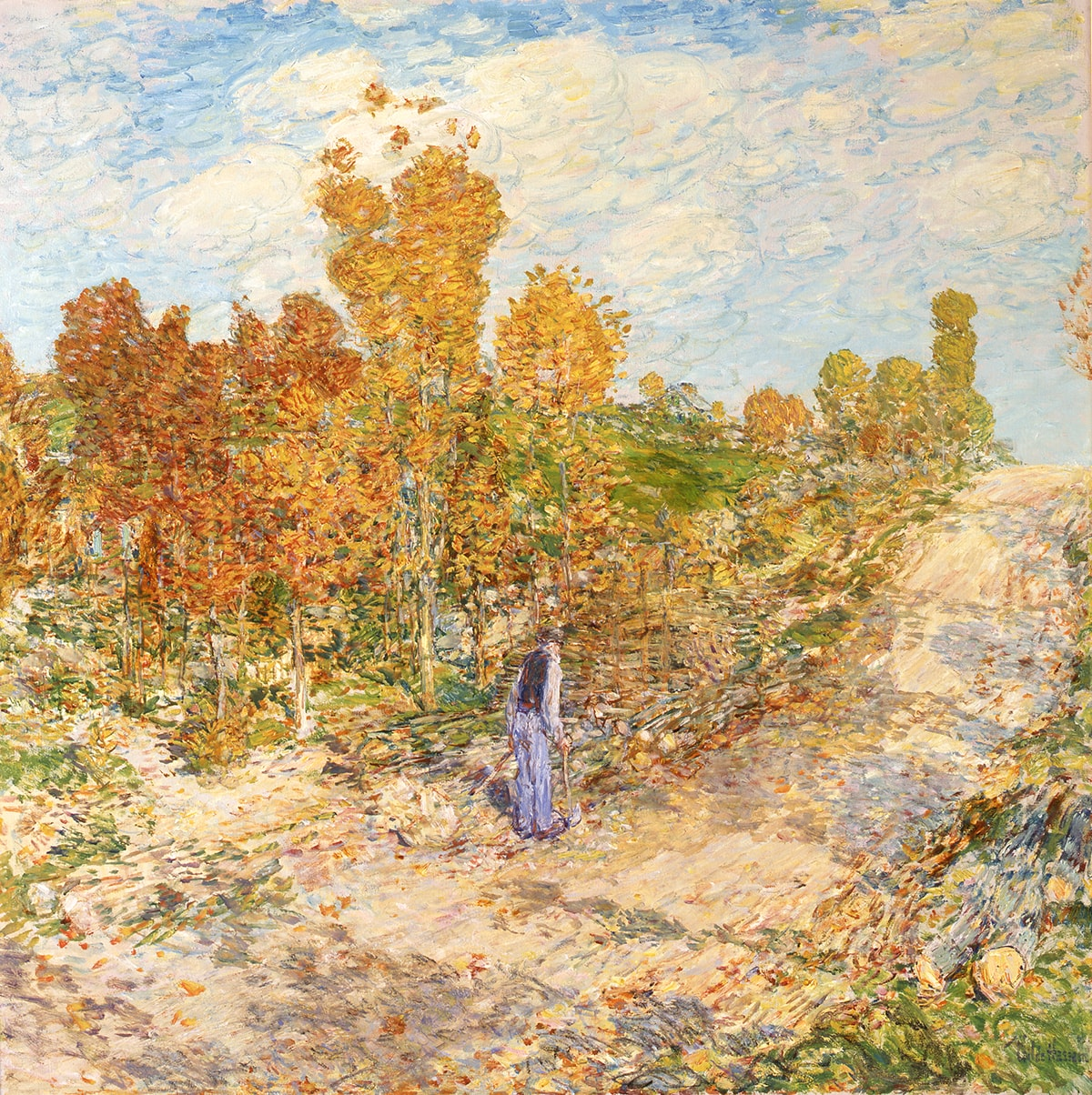 New England Road, Childe Hassam, 34 x 34 inches, oil on canvas. A square painting depicting a man walking along a rural road in autumn. The road is positioned diagonally across the painting starting at the lower left corner where it is broad and wide and continues to center right where it narrows slightly, ending at the horizon line a third of the way from the top. Shadows from nearby trees fall across the road's pale, tan surface. The top third of the painting is a blue sky with drifting, billowy clouds in pale, watery blues and whites. The center area of the work features a stand of trees with leaves of rusty red and yellow amid green grass, shrubbery, and fallen leaves. At center, a man stands with his back turned wearing a light-colored shirt, a dark vest, light blue trousers and a hat. He carries an ax as though he has been chopping wood at the roadside. Paint is applied with small brush strokes and colors are layered creating a soft effect without hard edges.