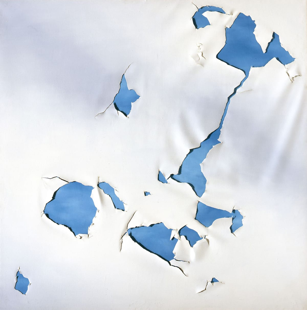 Torn Cloud Painting, Joe Goode, 60 x 60 inches, oil on canvas. A square work showing a white canvas torn to reveal a deep sky blue canvas beneath it. The tears begin in the upper right corner with a small roughly crescent shaped tear and a larger irregular jagged tear that connects via a narrow, crooked fissure to a triangular tear near the center of the work. Three more tears are located below and another two slightly above and to the left. Smaller diamond-shaped tears appear at upper center left and lower left. The edges of the tears are ragged with the canvas fraying in spots. Shallow folds of loose canvas are visible as the material sags in spots. These create shadows in addition to the ones made on the blue canvas by the gaping holes.