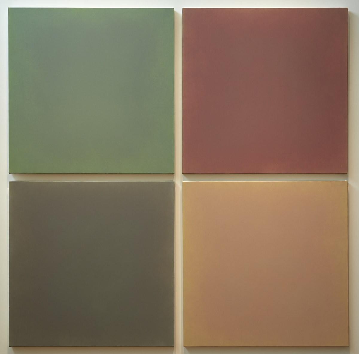 [Image description: Requiem for a Ponderosa Pine, Anne Appleby, each panel 44 x 44 inches; overall: 90 x 90 inches, oil and wax on canvas. Four square panels, each a different color, grouped to form one larger square. The panels are arranged two over two. At top left, the first panel is a deep green and at top right the panel is reddish-purple. Bottom left contains the blackish-brown panel next to the faded orange or cantaloupe colored one at bottom right. The squares are hung so they are separated by narrow strips of the wall behind them. The panels appear to be solid blocks of color but closer inspection reveals subtle variations of shades and depth of color.]