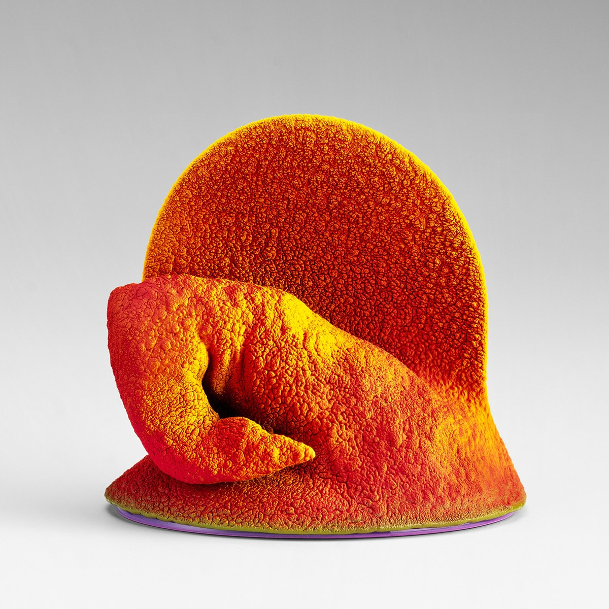 """Image description: Fortgang, Ron Nagle, 4 ¾ x 4 ¾ x 4 inches, earthenware with overglaze. A small, bright orange sculpture featuring a circular """"fin"""" behind a curled, finger-like appendage. The fin stands about twice as high as the crooked finger that ends in a point. The appendage appears to have several joints like a human finger with folds or wrinkles where it bends. The base widens slightly and appears rounded. The rough, craggy surface of the sculpture shows lighter highlights amid the deeper orange shadows."""