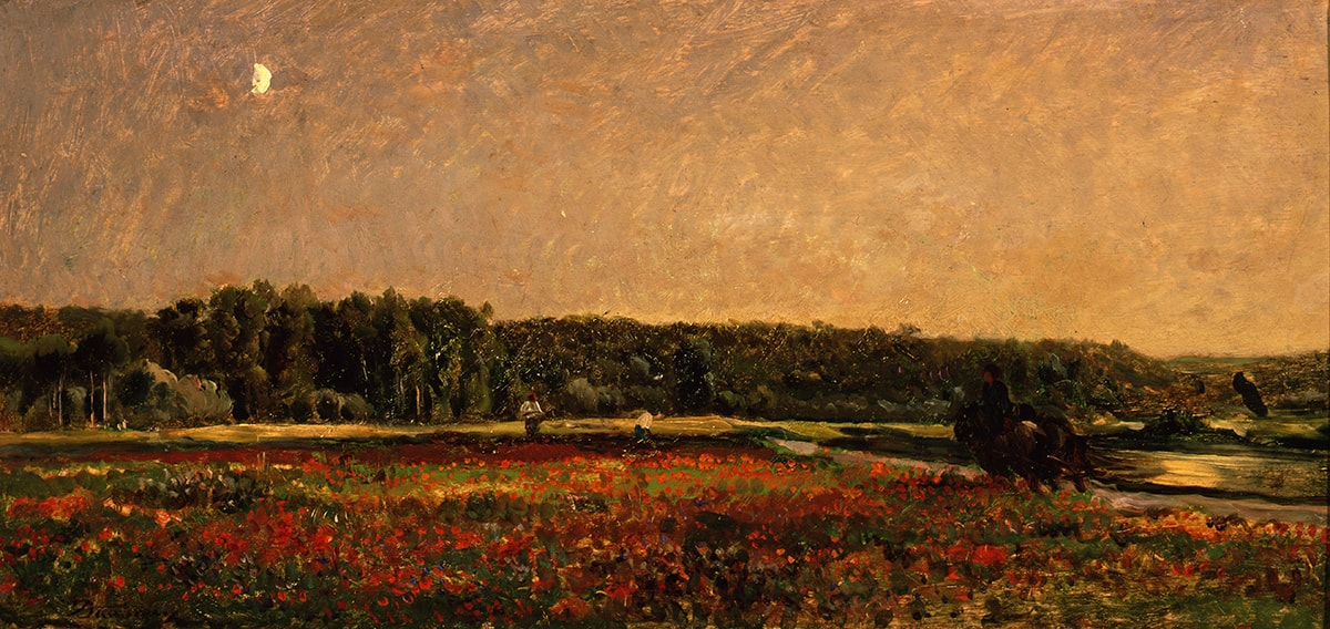 """Image description: """"Field of Poppies."""" Charles-François Daubigny. 1860/1878. Oil on panel. 11 1/4 x 23 7/8 inches. This warm, rural landscape features a field of bright red poppies in the foreground and a dense row of leafy green trees along the horizon. The luminous sky--golden on the right, suggesting the rising sun just below the trees--melts into lavender on the left punctuated by a bright, white moon. On the right, a figure on horseback rides away from the viewer, following the diagonal line of a river behind the poppies and leading toward the center of the painting, where two people work the field. The painting style anticipates Impressionism in its attention to light and the use of visible, expressive brush strokes."""