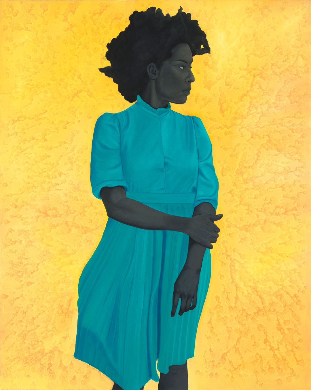 Image description: Saint Woman, Amy Sherald, 54 x 43 inches, oil on canvas. A portrait of a Black woman in a blue dress, looking to the side against a brilliant yellow background. The woman is shown from the knee up, her body facing front while her head is turned to the right. Her dark skin is painted in hues of deep gray. Her hair is big and full, creating a cloud of black curls around her face. She has high cheekbones, fine arched eyebrows and dark eyes. She wears a high necked turquoise blue dress with elbow length sleeves puffed at the shoulder. Her right arm crosses her body and grasps her left arm which rests by her side. The skirt of her blue dress is softly pleated and gently flares out to the left as if caught in a breeze. The bright yellow textured background seems to glow behind her.
